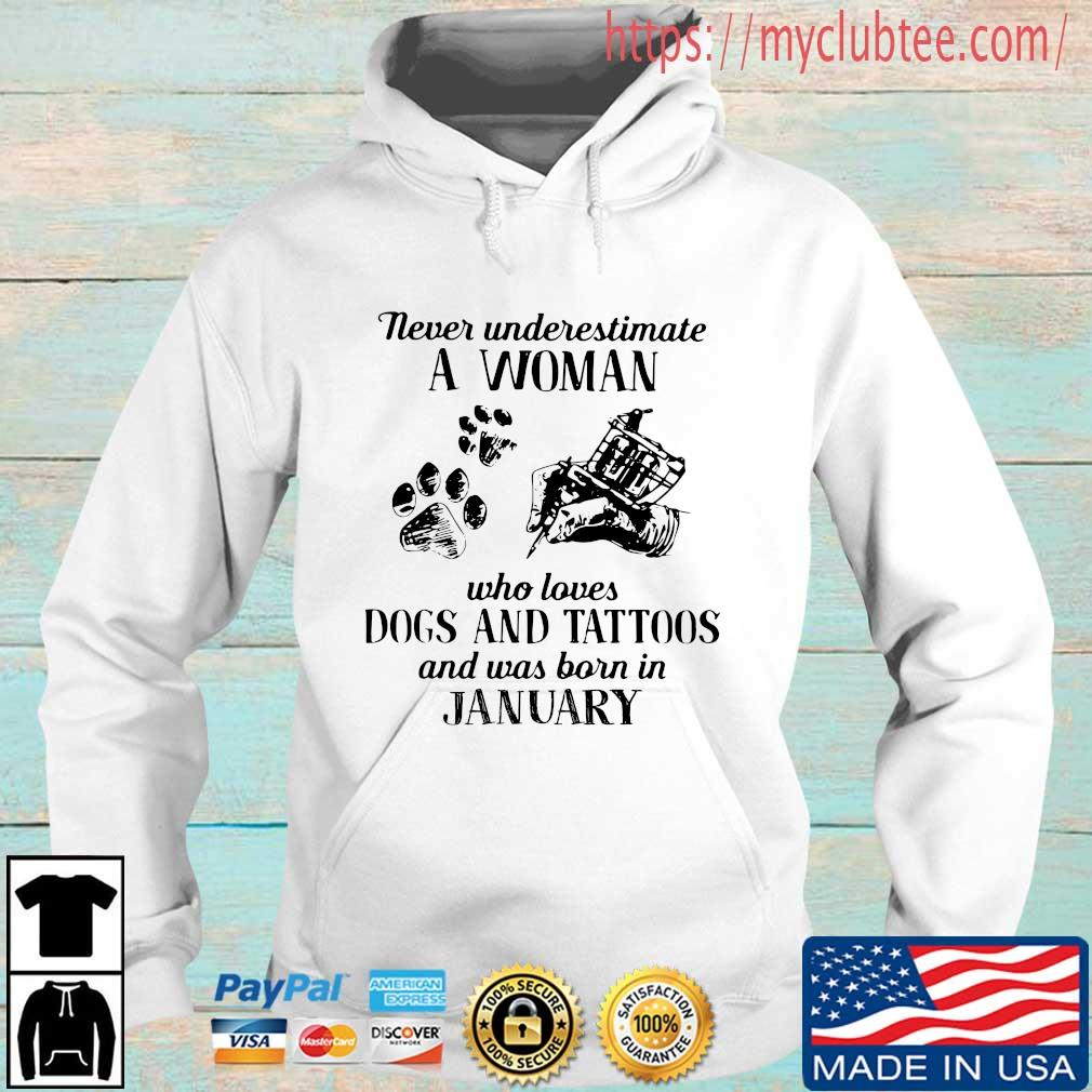 Never underestimate a woman who loves dogs and tattoos and was born in january Hoodie trang